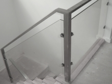 Stainless steel square section balustrade and handrail with glass infill made by Metalcraft Engineering